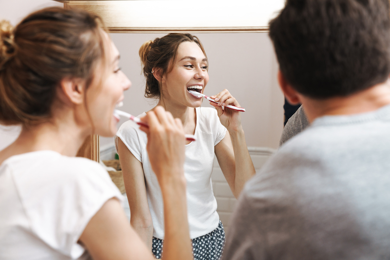 image-of-attractive-couple-cleaning-teeth-together-F3RMUTM