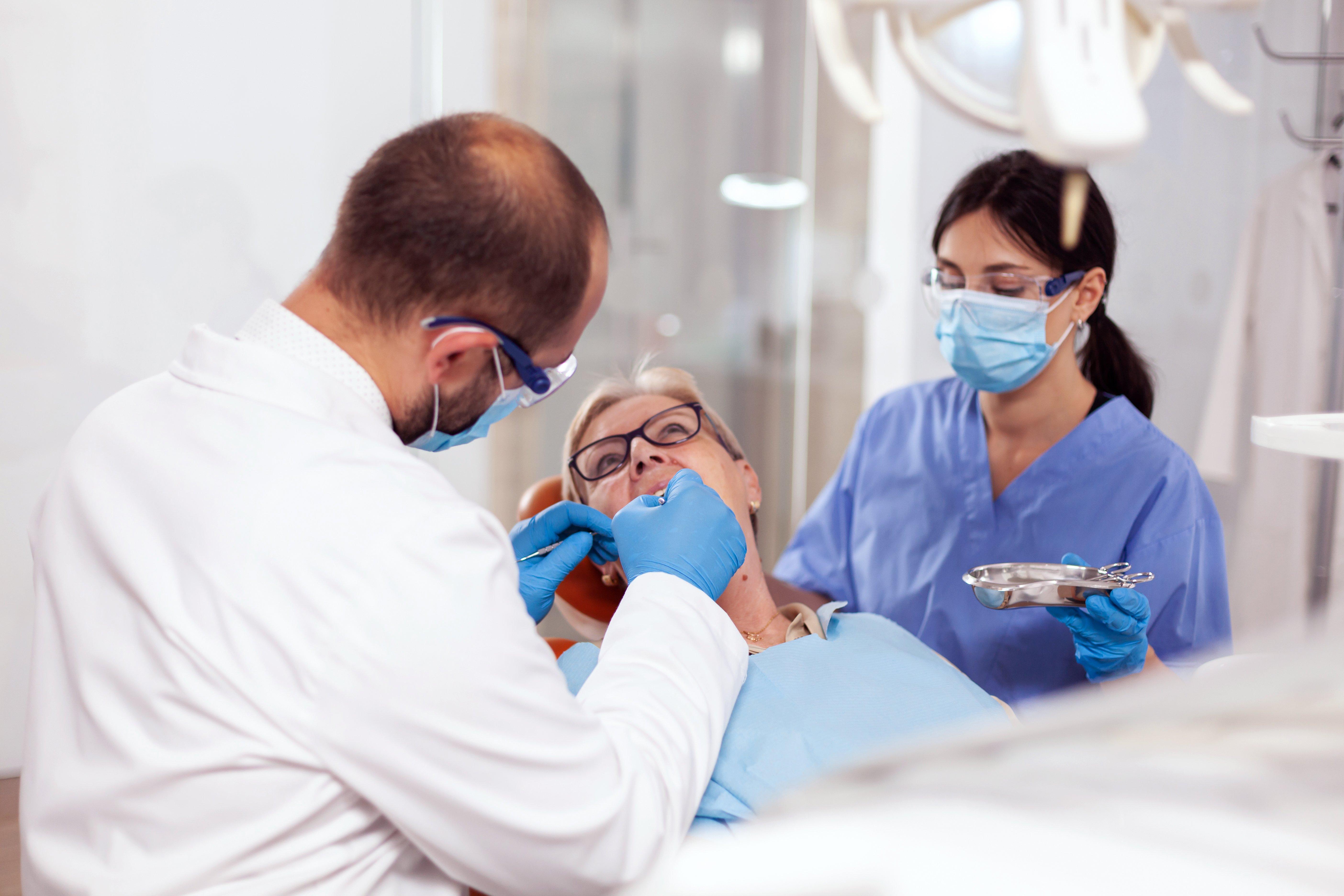 senior-woman-getting-stomatology-treatment-N9DK3F4